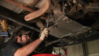Auto Mechanic Under Carraige Changing Oil