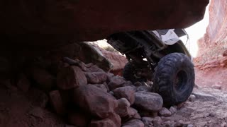Back Wheels of Jeep Get Over Rock Ledge