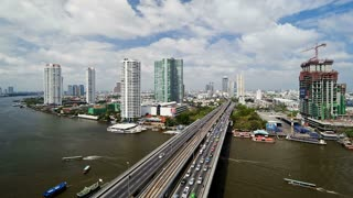 Bangkok and the Chao Phraya River crossed by Modern Motorway system in Time Lapse, Thailand, Asia