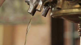bar tap dripping beer