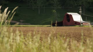 Barn And Tilled Farm