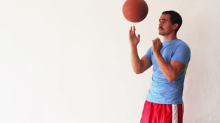 Basketball player spinnig a ball