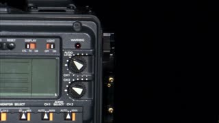Battery Being Attached to Back of a Camera