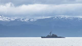 Battleship Passes Mountain Range
