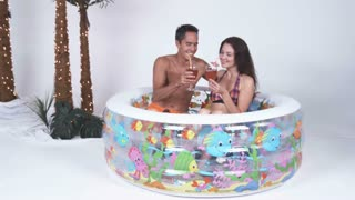 Beach Couple Drinking in Kiddie Pool