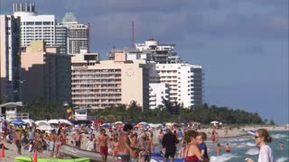 Beach in Miami with People Playing in Ocean
