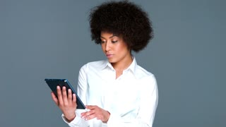 Beautiful African American woman on a tablet
