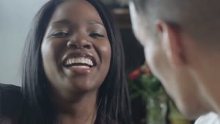 Beautiful African American Woman smiling during conversation with man