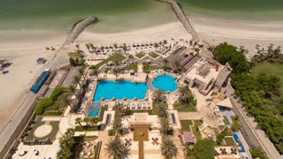 Beautiful area of beach in Ajman timelapse near the turquoise waters of Arabian Gulf, UAE. Panoramic rooftop view. 4K