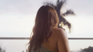 Beautiful Girl Stares Out Window To Tropical Paradise