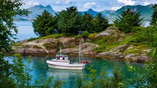 Beautiful Nature Norway natural landscape. Boat on the water