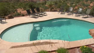 Beautiful Pool With Redrock Desert In Distance