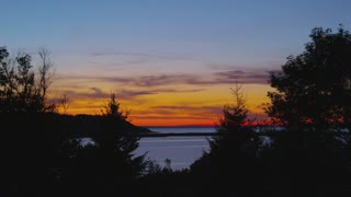 Beautiful Sunset Over Nova Scotia Bay Through Trees