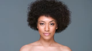 Beautiful woman clutching her afro hairstyle
