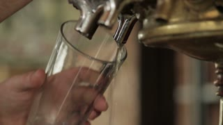 beer pour from bar tap, with sound
