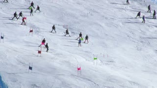 Beginners Skiing Down Slope