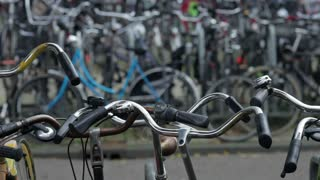 Bicycles parked outside the main train station in Amsterdam, Holland, Netherlands