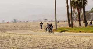 Bicyclists Riding Along California Beach Bike Path