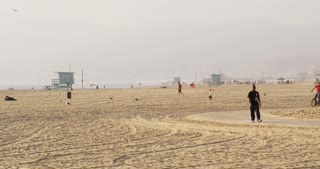 Bicyclists Riding Along California Beach
