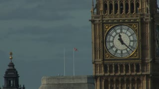 Big Ben Clock With Flag In Background