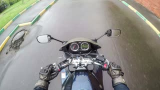 Biker rides on the road in the city - time lapse