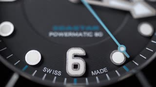 Black clock dial with blue second hand. Slow motion macro video