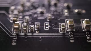 Black computer circuit board macro dolly shot