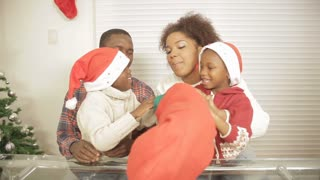 Black family opening stocking christmas gift