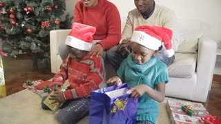 Black family opening theirs christmas gifts