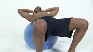 Black Man Does Sit-Ups on Exercise Ball 2