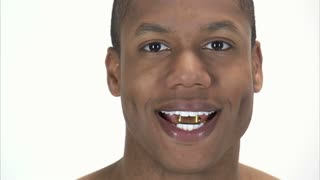 Black Man Holding Pill Between His Teeth 2
