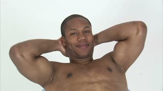 Black Man in Sit Ups Position on Ball Smiling