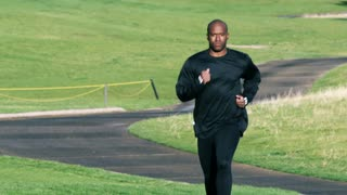 Black Man Running on a Trail in Slow Motion 2