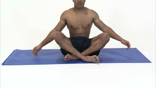 Black Man Shirtless Stretching on Blue Mat 2