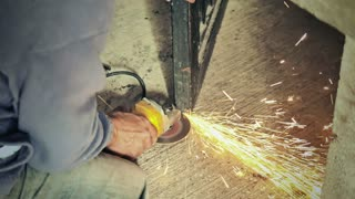 Blacksmith using angle grinder