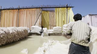 Bleaching pool in a Sari garment factory, Rajasthan, India, Asia, MR,PR