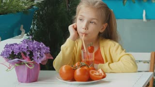 Blonde girl drinking tomato juice and laughing at camera. Thumbs up. Ok. Zooming