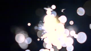 Blue and orange burning sparkler against dark background. Super slow motion bokeh video