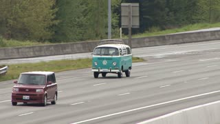 Blue Microbus Driving on Freeway