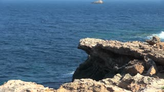 Blue Ocean and Jagged Rocks in Spain