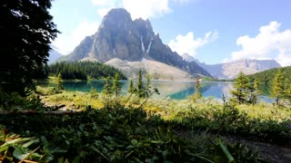 Blue skies and teal water in Mount Assiniboine Provincial Park Canadian Rocky Mountains