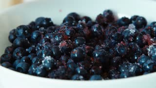 Blueberries sprinkled with sugar. Zooming. Closeup