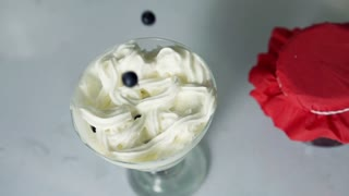 Blueberry fall into whipped cream dessert, super slow motion, shot at 480fps