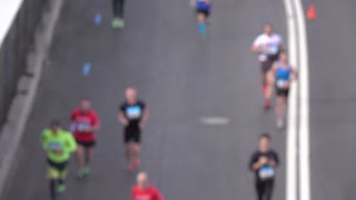 Blurred city marathon runners. Competition concept. Slow motion background bokeh shot, view from above
