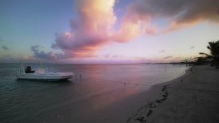 Boat at pink sunset