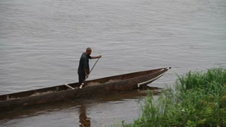 Boat On The Congo River With Two Men