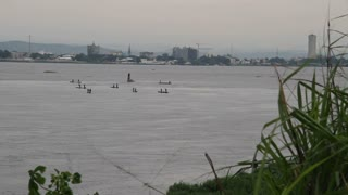 Boats On The Congo River With City And Background