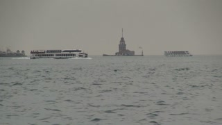 Boats Passing by Maidens Tower on Bosphorus