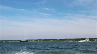 Boats Traversing Pristine Waters Time Lapse