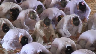 Bowing In Vietnamese Temple